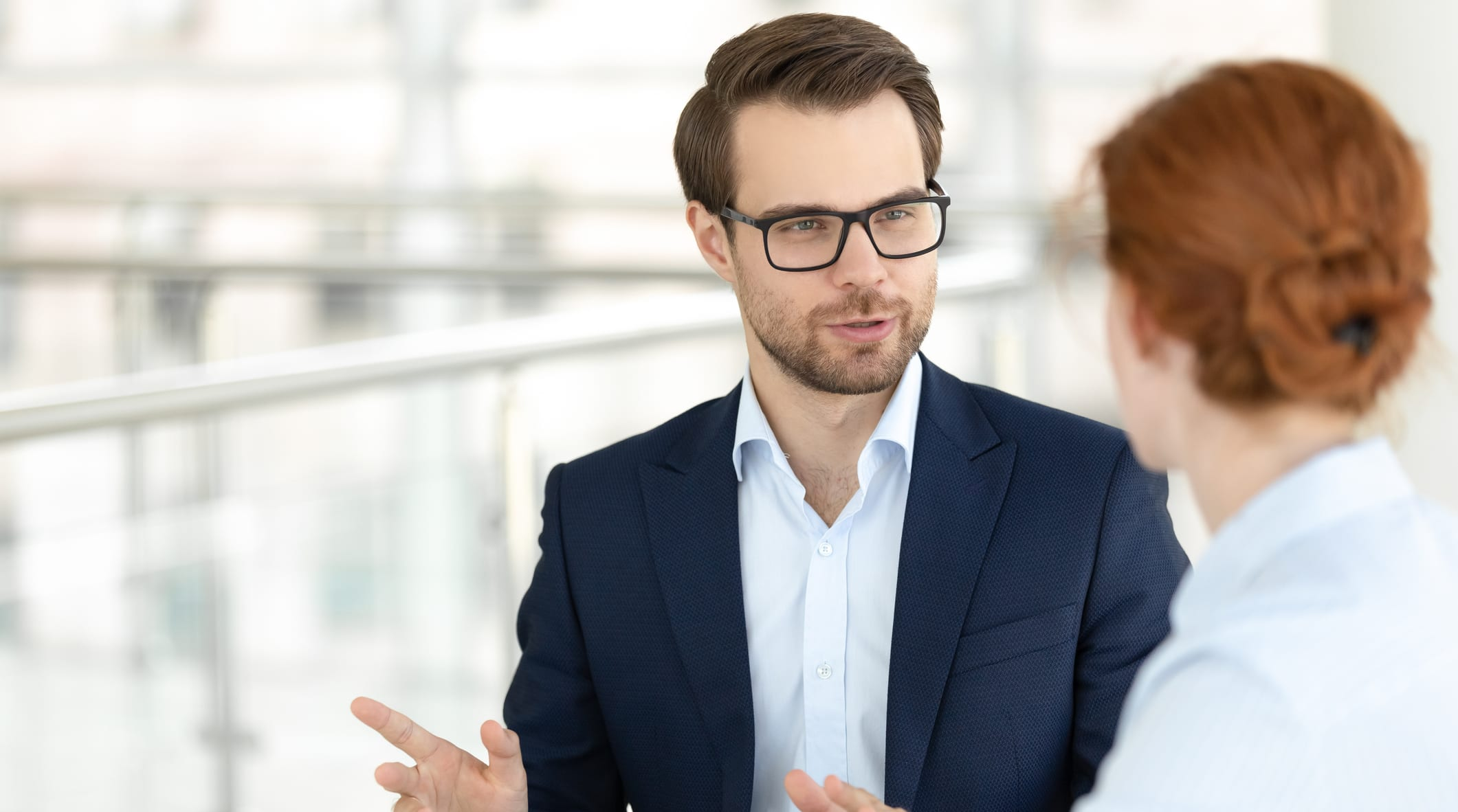 Salesperson asking probing questions to prospect