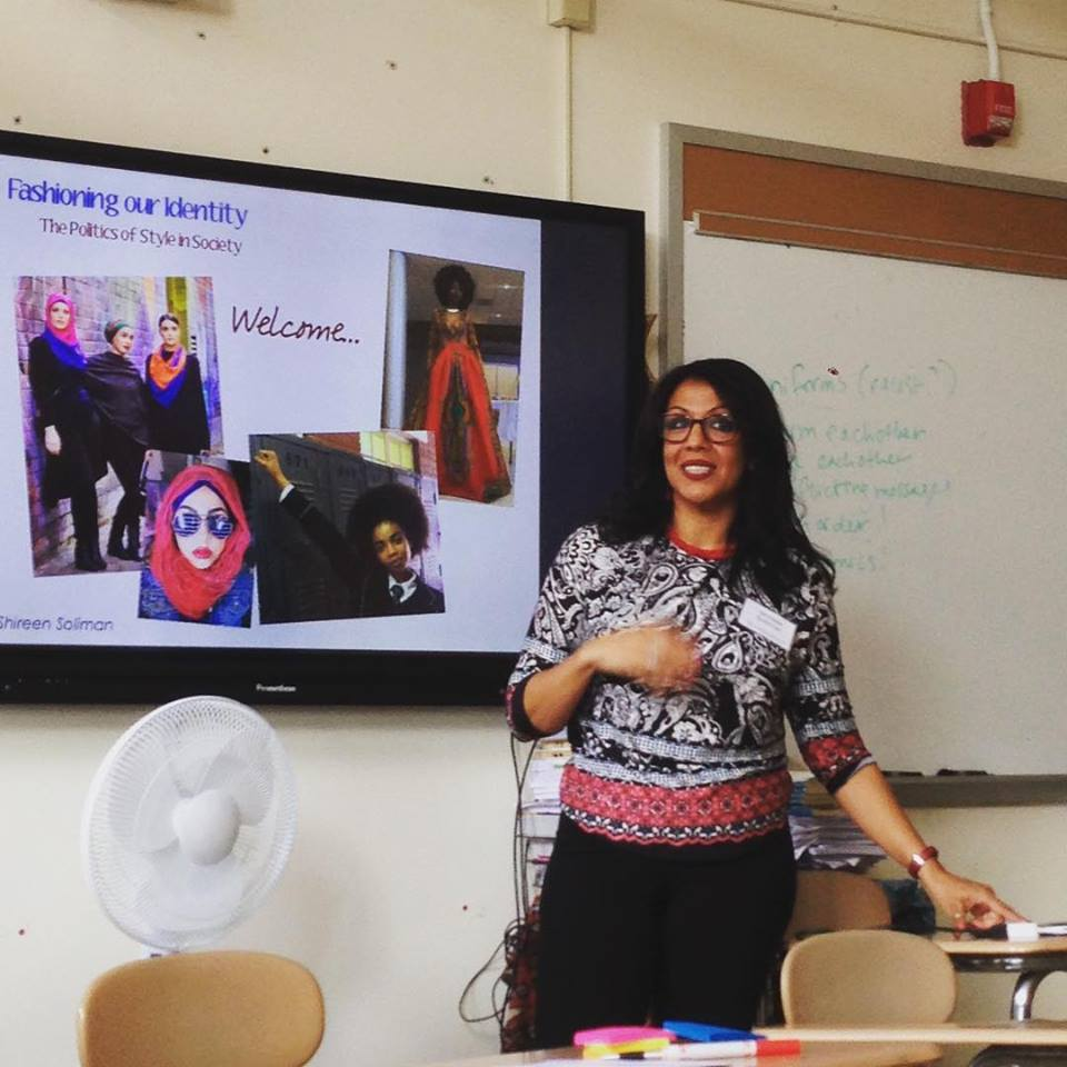 Shireen presenting a project on a digital screen in a classroom