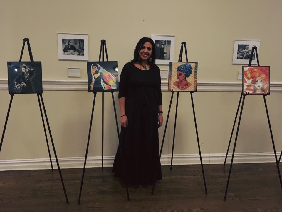 Shireen standing with 4 art pieces