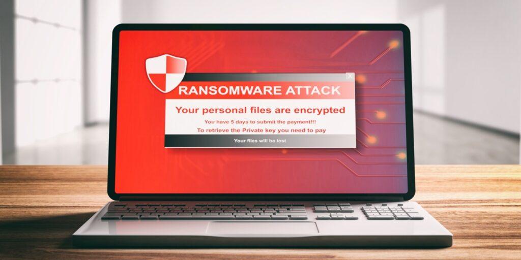 Laptop displaying ransomware attack banner