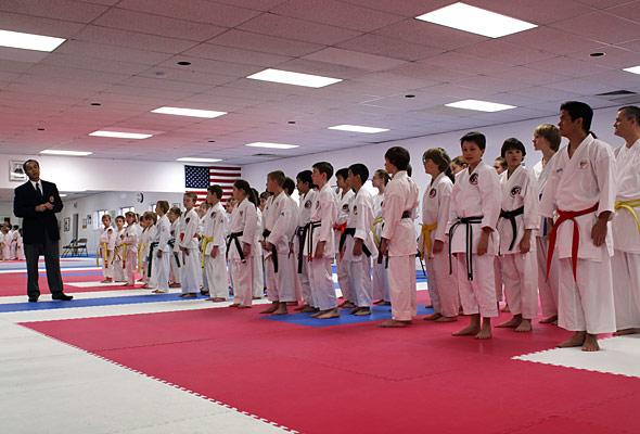 Hanshi Madani talks to students before the start of the Annual IMA Karate Tournament