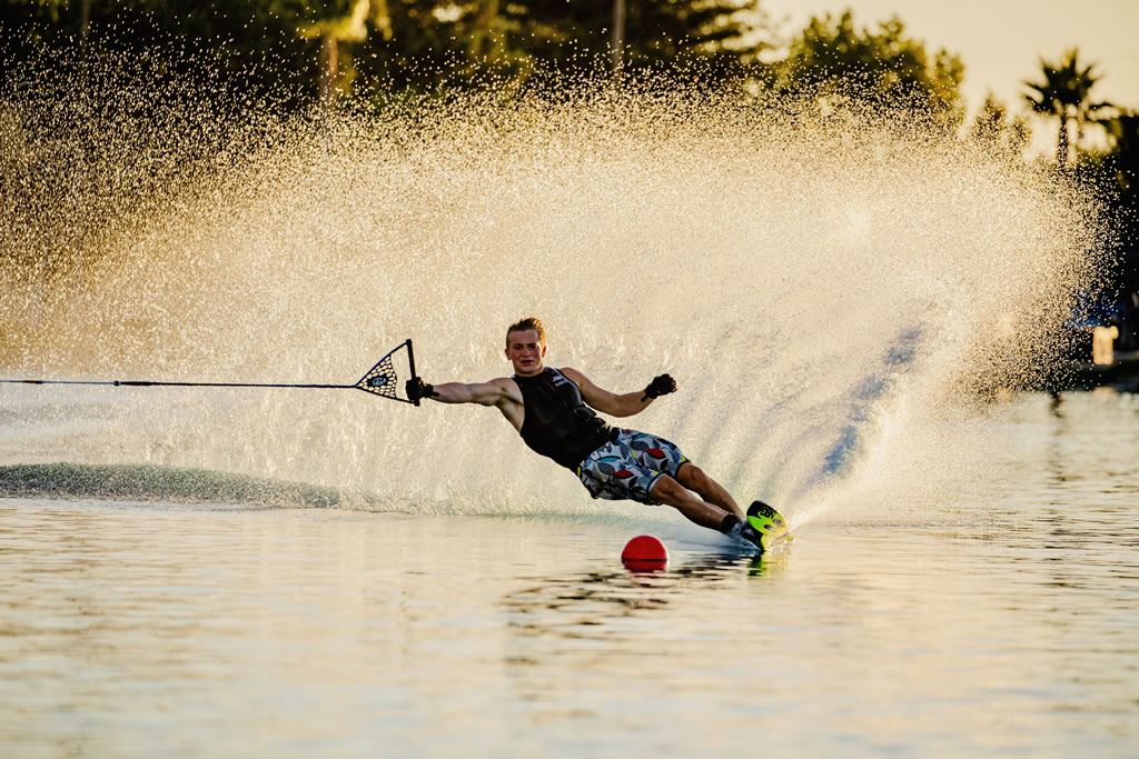 male water skier rounding buoy