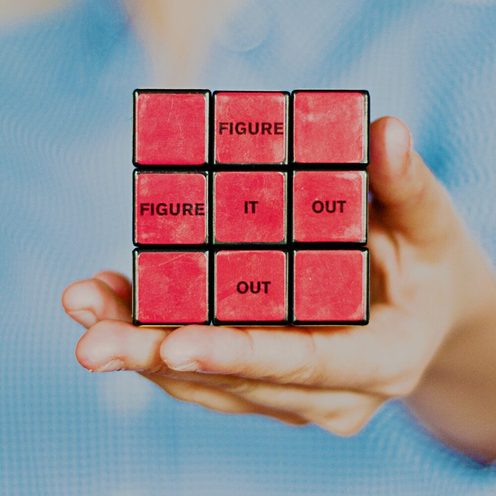 puzzle cube with words 'figure it out'