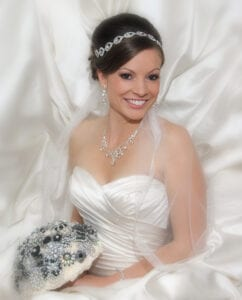 A bride holding a white and silver bouquet