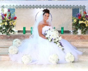A bride sitting on the stairs