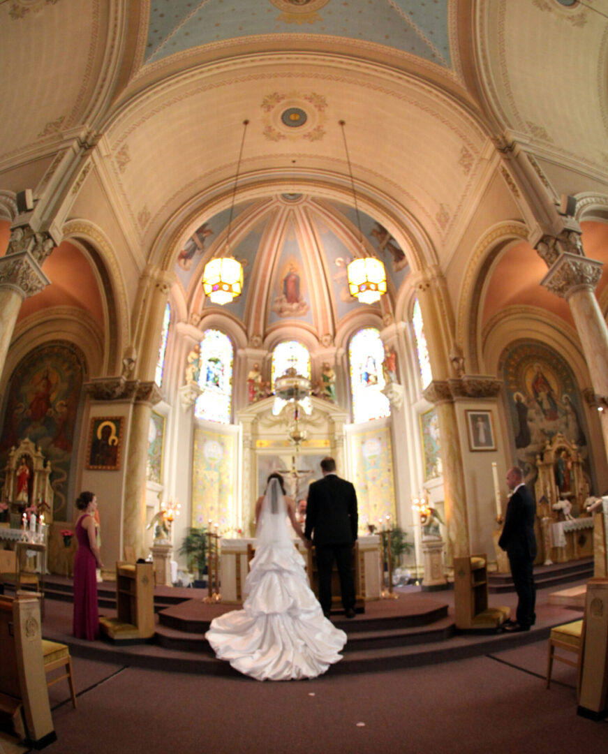 The bride and the groom in front of the altar, 2