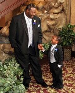 The groom and a young boy in a suit