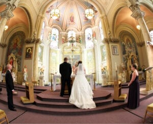 The bride and the groom in front of the altar, 1
