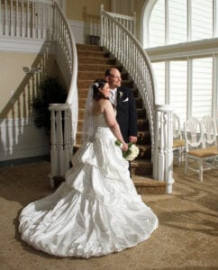 The newlyweds at the bottom of the staircase