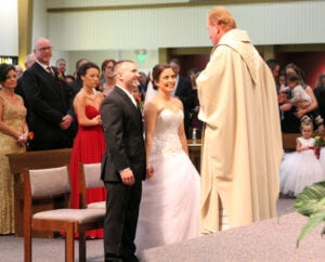 The newlyweds listening to the priest