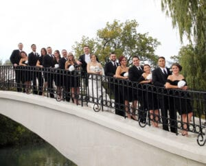 The bride and the groom and their wedding party in black