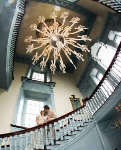 A bride and a groom kissing on a blue staircase