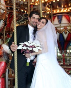 The bride and the groom in a merry-go-round
