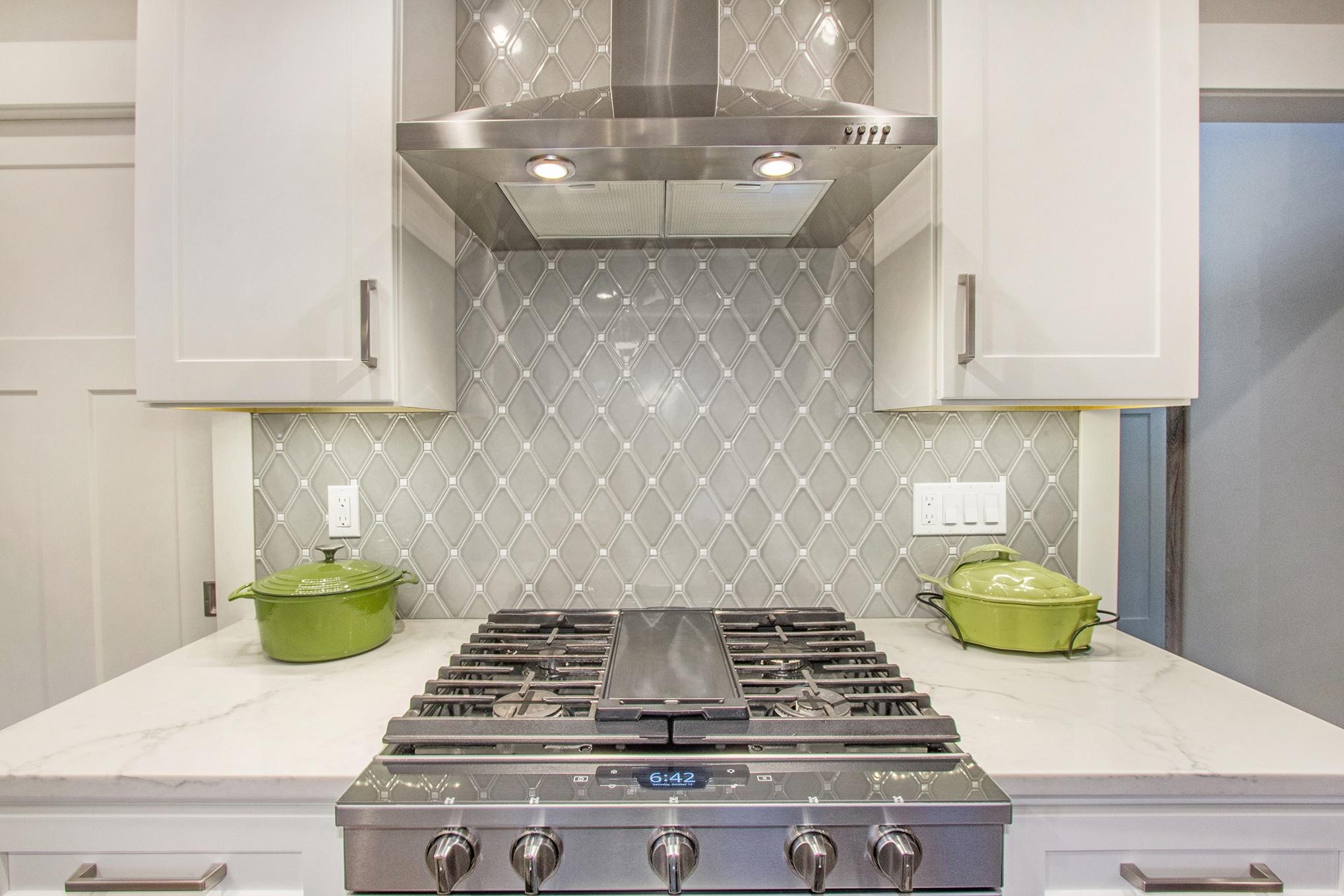 Custom Home Chef's Range with Hood Vent and Custom Tile Wall