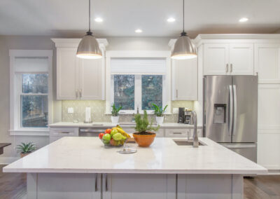 Custom Home Marble Kitchen Island and White Cabinets