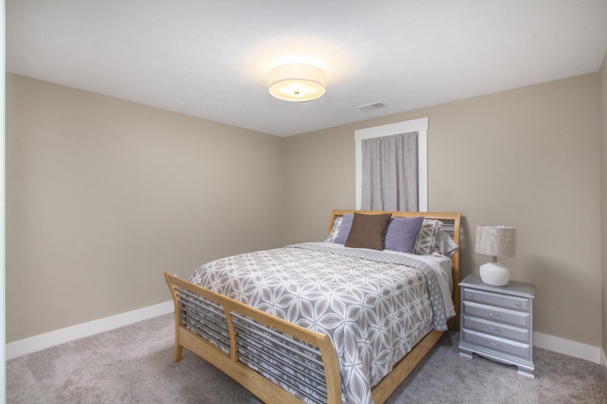 Custom Home Finished Basement Bedroom with Egress Window
