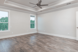 Empty room with ceiling fan and windows