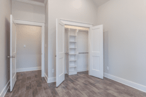 room with two doors and cabinets