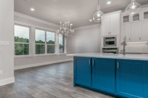 kitchen with ceiling lights, chandelier, counter, and shelves