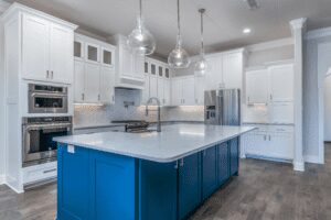 blue kitchen island with cabinets and ovens