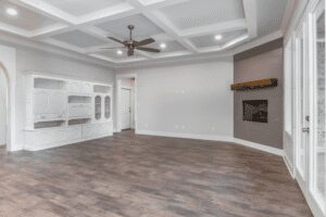 large room with ceiling fan and white cabinet