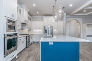 furnished kitchen with marble countertop and blue cabinet