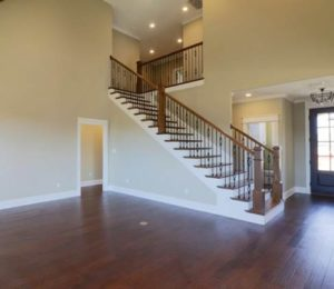 two-story staircase with dark wood