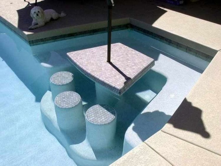 Table and seats in pool