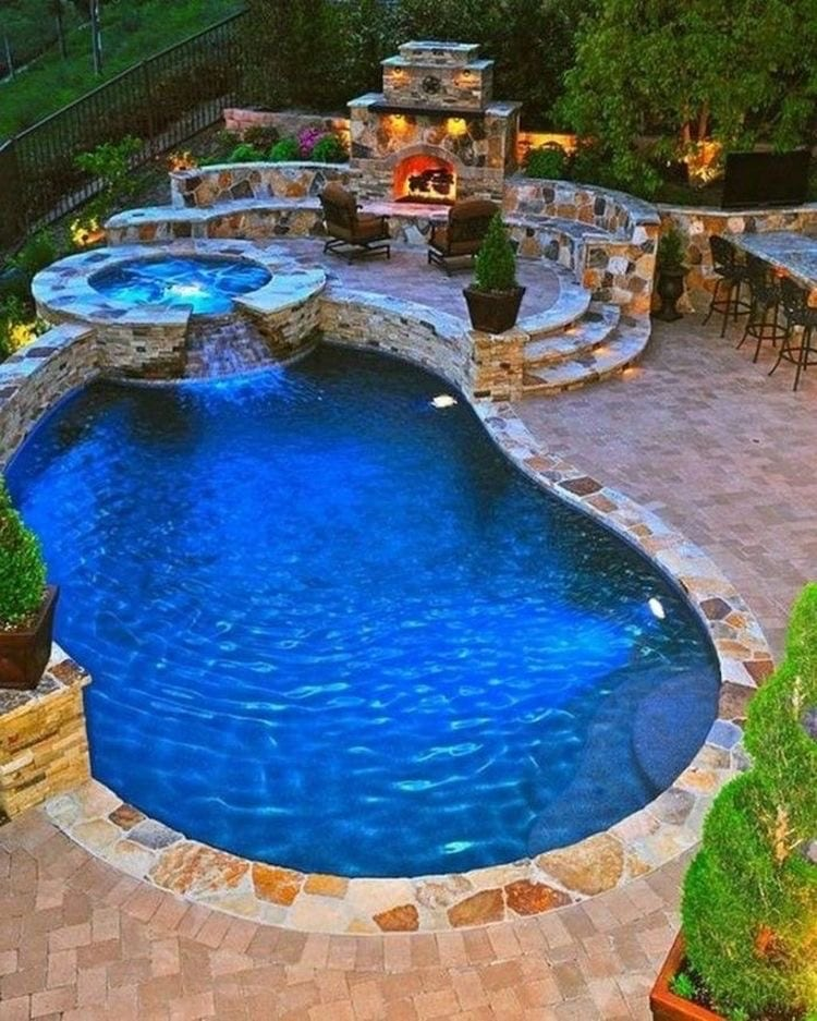Luxurious outdoor area and pool with mini waterfall