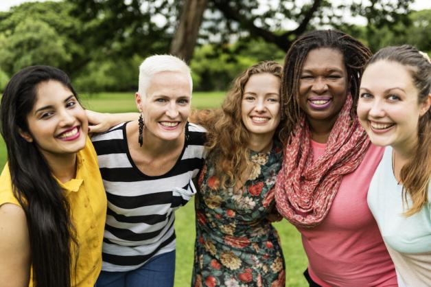 five girls smiling