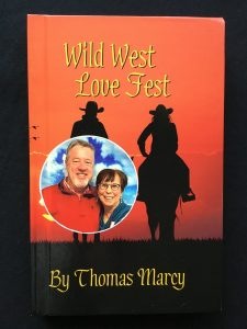 Tom and Marcy Gallagher appear on the cover of the new book they wrote for YourNovel.com, Wild West Love Fest with the pen name Thomas Marcy.