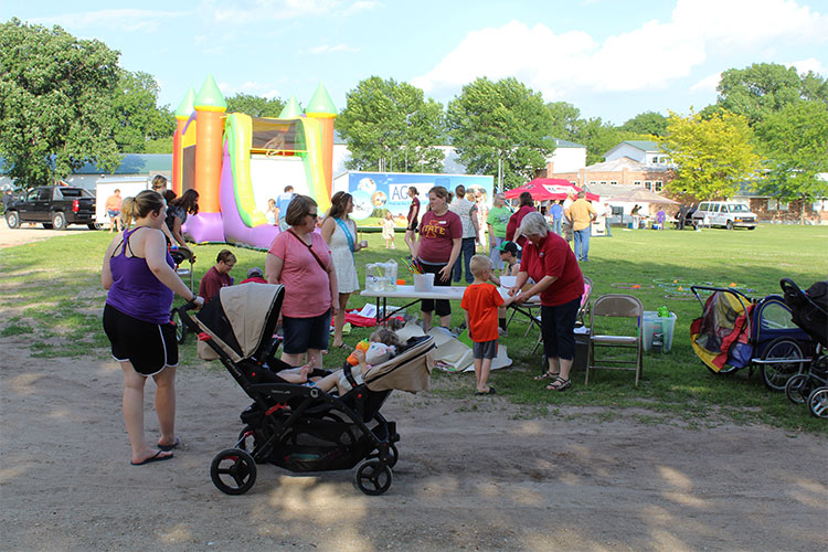 parents and kids at fairgrounds