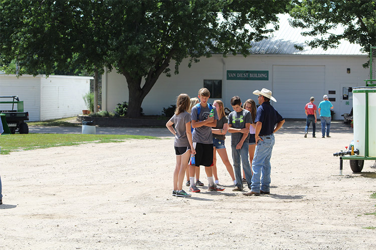 group of people talking at the fair