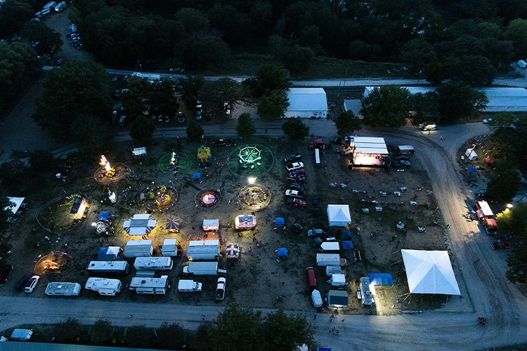 Aerial view of fairgrounds at night