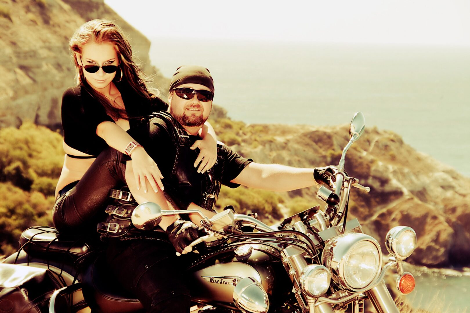 The in love pair on a motorcycle on a background of the sea
