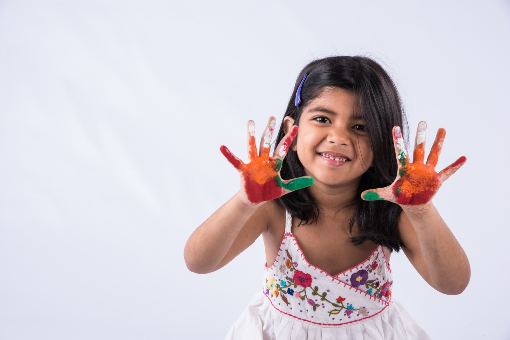 StockImageFactory.com-photo-ID(0000143113)indian-cute-girl-with-colourful-palm-over-white-background