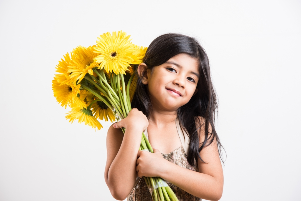 StockImageFactory.com-photo-ID(0000144940)small-girl-holding-flower-bouquet-bunch-of-flowers