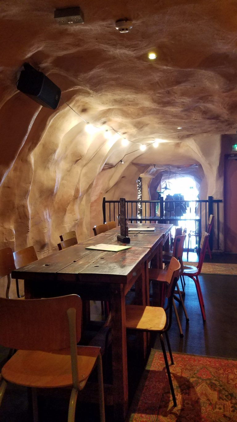 Tempest Pub Table in Cave Like Bar