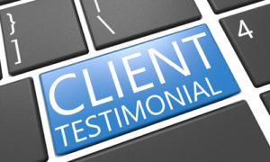 client testimonial on a keyboard