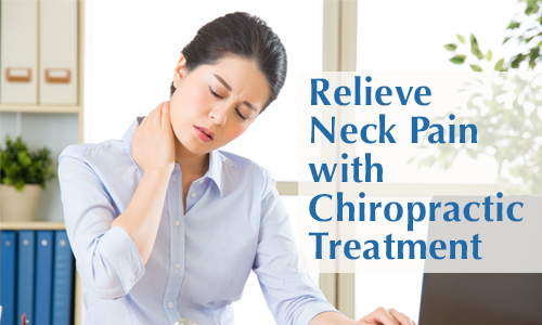 image of woman holding her sore neck