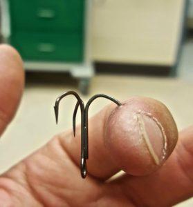 Megabass Out-Barb Hook in Finger.