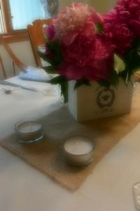 Tea lights, linen and peonies   https://juliesaffrin.com