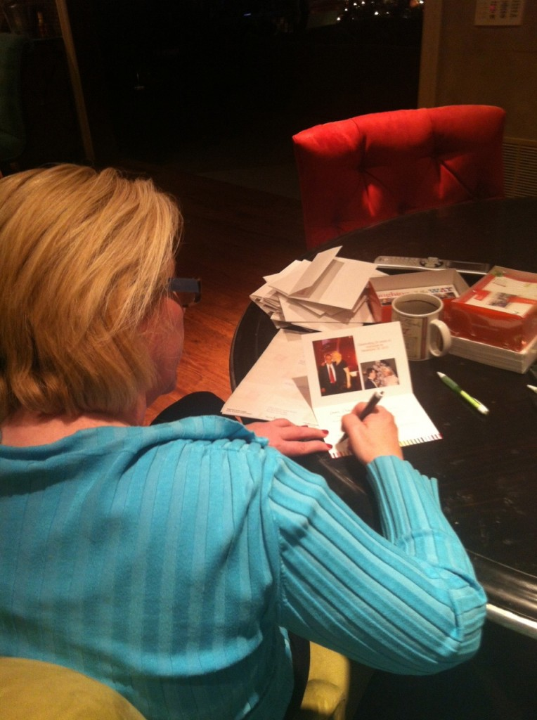 Bonnie McGrath penning a personal note on one of the 800 Christmas cards she sends   juliesaffrin.com
