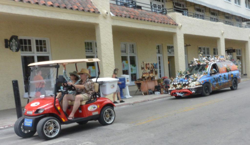 Classic Key West. Tourists and a hippie peace car