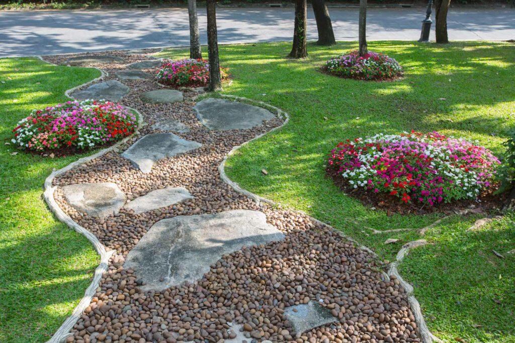 Pathway winding through garden
