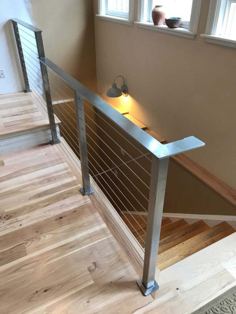Steel cable system with stainless steel handrail.