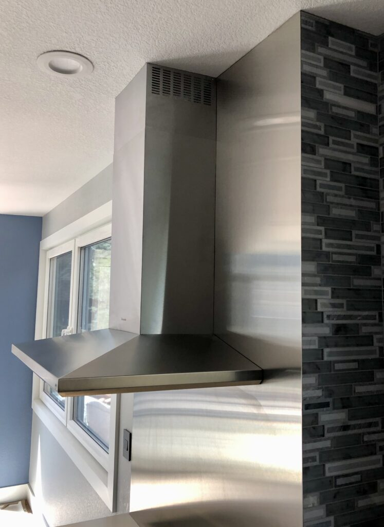 Stainless steel backsplash and vent hood
