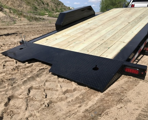 2020 TB Series Tilt Bed Trailer, showing the bed, tilted, on the sand.