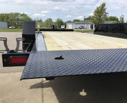 2020 TB Series Tilt Bed Trailer, flat, showing knife edge, in a parking lot.
