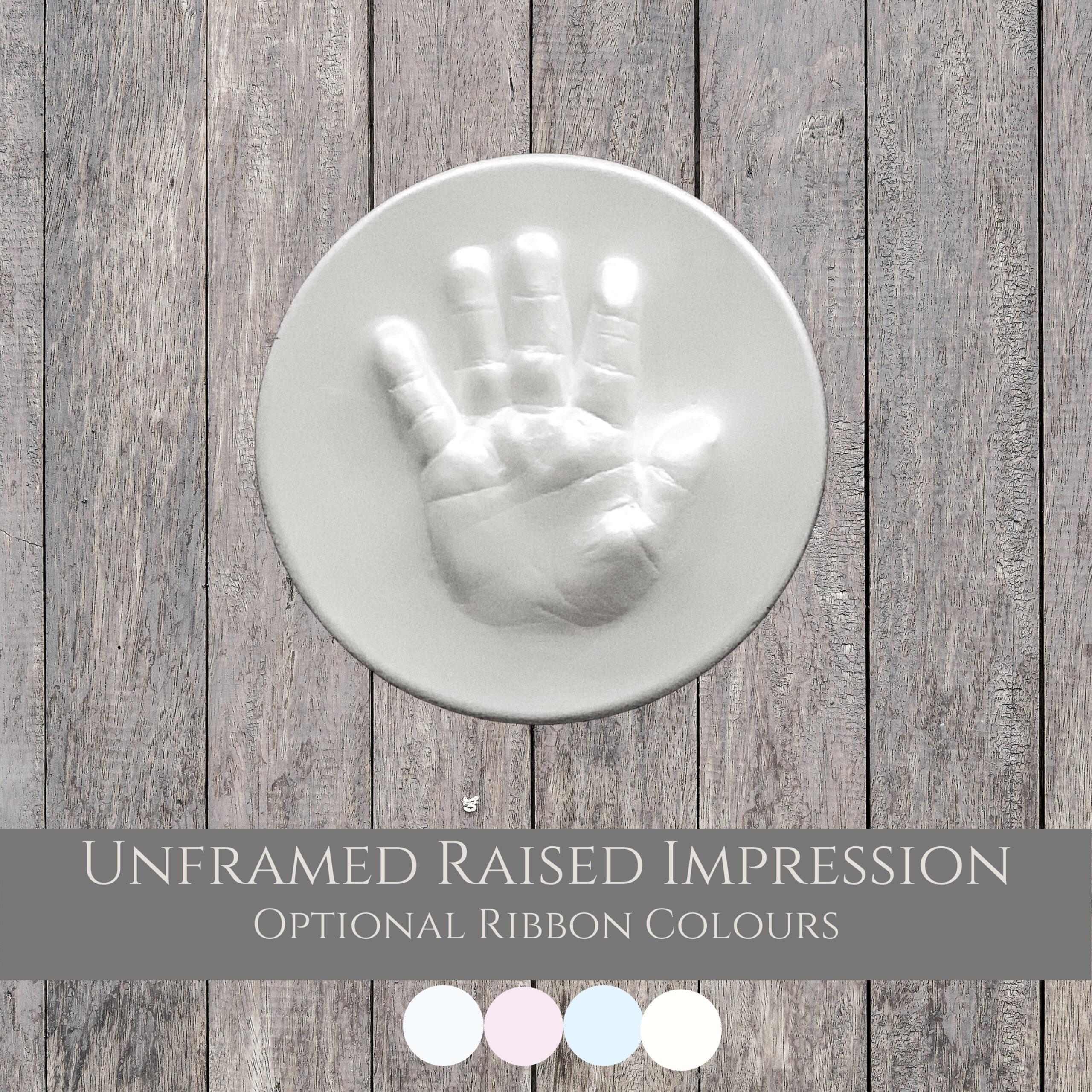 unmounted hand raised impression